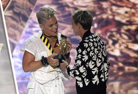 Pink, left, accepts the MTV Michael Jackson Video Vanguard Award from Ellen DeGeneres at the MTV Video Music Awards at The Forum on Sunday, Aug. 27, 2017, in Inglewood, Calif.