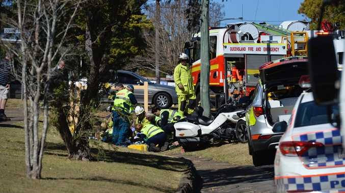 Emergency services at the scene of a car and motorbike incident on the corner of Perth and Cohoe Sts at Rangeville on Monday, August 28.