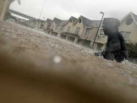 A child makes his way through floodwaters from Tropical Storm Harvey while checking on neighbours at his apartment complex in Houston, Sunday, Aug. 27, 2017. The remnants of Hurricane Harvey sent devastating floods pouring into Houston Sunday as rising water chased thousands of people to rooftops or higher ground.
