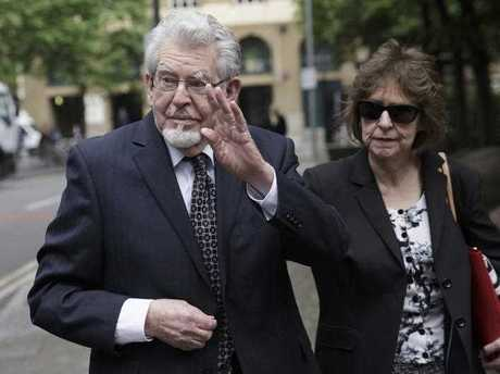 Convicted Sex offender Rolf Harris, left, gestures as he arrives at Southwark Crown Court with his niece Jenny Harris, right, where he is on trial for several counts of alleged indecent assault, in London, Monday, May 22, 2017.