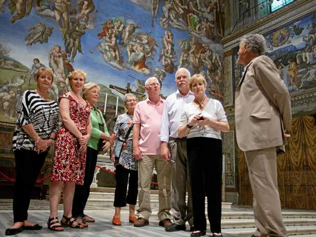 GROUP TRAVEL: Academy Travel tour group enjoying a private tour of the Sistine Chapel in Rome, Italy.