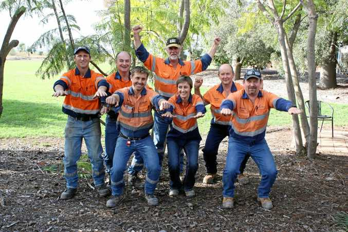 GET HEALTHY: New Acland workers get in some stretching (back, from left) Mick Hartin, Gordon Evans, Gavin Beutel, (front, from left) Paul Robb, Natalie Kimber, Dave Anderson and Alain Puig.