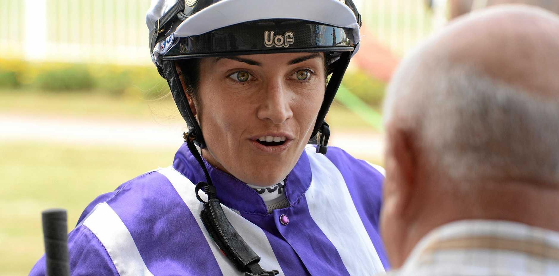 Jockey Tegan Harrison chats to trainer Mario Caltabiano after winning aboard Scoutaboard at Bundamba Racetrack on Friday.