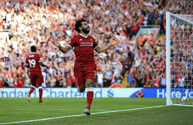 Liverpool's Mohamed Salah celebrates scoring his side's third goal in the 4-0 win over Aresnal.