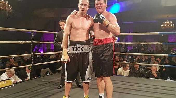 Former Richmond midfielder Shane Tuck (left) and Toowoomba fighter Steven Roberts after their fight ended in a draw in Melbourne on the weekend.