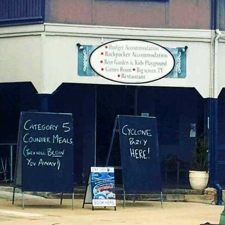 A sign out the front of an Ayr pub a day before Cyclone Debbie hit.