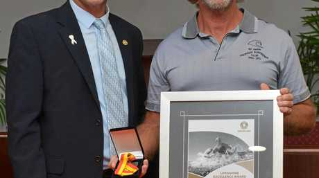 AWARDS: Cr David Batt presents Daren Keena with an award at the Bundaberg Council Chambers for a rescue at Elliot Heads.