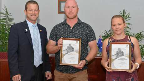 AWARDS: Cr David Batt presents Mick and Sherylea Gray with an award at the Bundaberg Council Chambers for a rescue at Elliot Heads.
