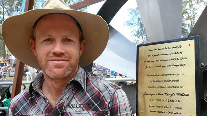 MEMORIAL: Ben Willcox with Jasmyn's plaque at The Gympie Music Muster, Amamoor Creek State Forest.