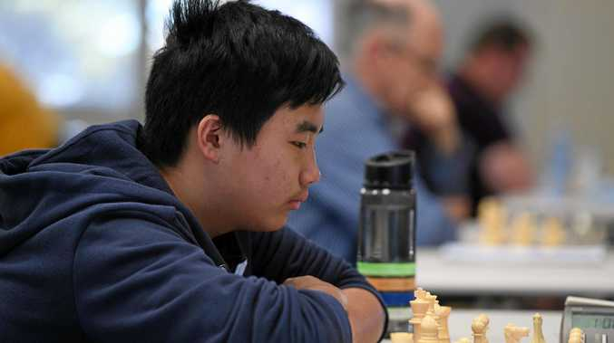 Tony Zhong waits for his opponent to make his next move.
