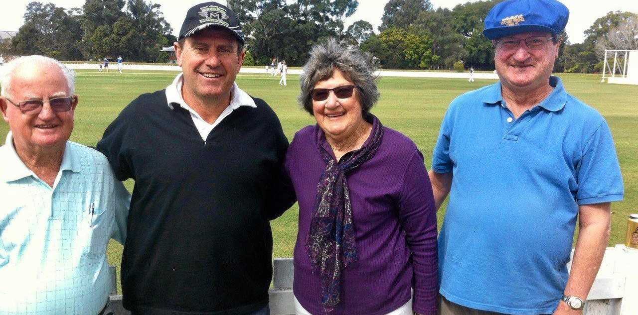 Former Australian Test captain and Channel Nine commentator Mark Taylor (middle) watched the cricket at Harwood Oval.
