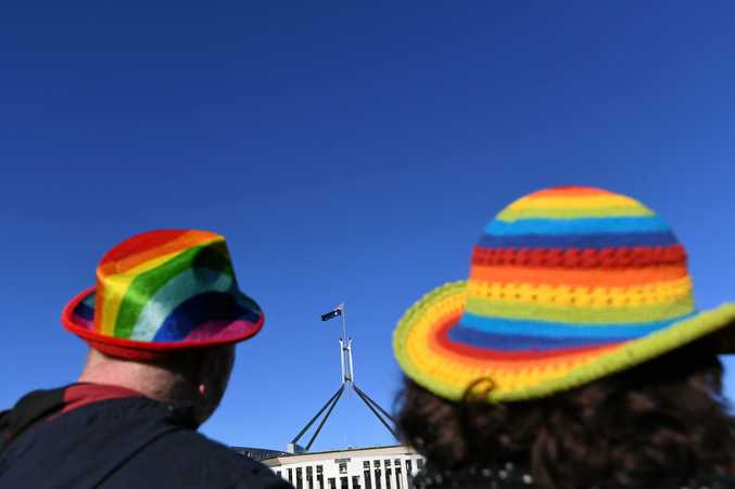 Marriage equality advocates are seen during the 'Sea of Hearts' event outside Parliament House in Canberra last month.