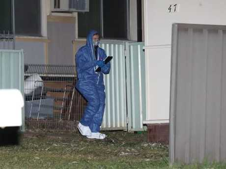A forensic officer entering the house.