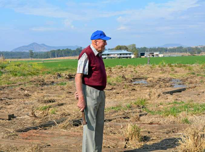 GONE: Lockyer Valley Flying Club secretary Bill Hill looks across the Grantham site where the steel making up the club's hangar was stolen.