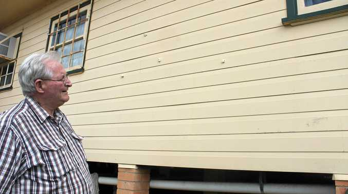 DAMAGE: Bob Wilson, from the Alstonville RSL Sub-Branch, looks over the patched holes in the rear wall of the RSL Hall, where vandals damaged the wall.