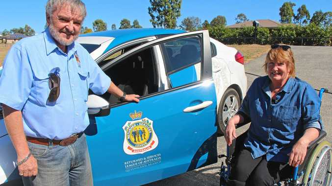 HELPING HANDS: Alex Rigby of the Lowood RSL sub-branch was happy to help Ms McNair after reading about her travel woes.