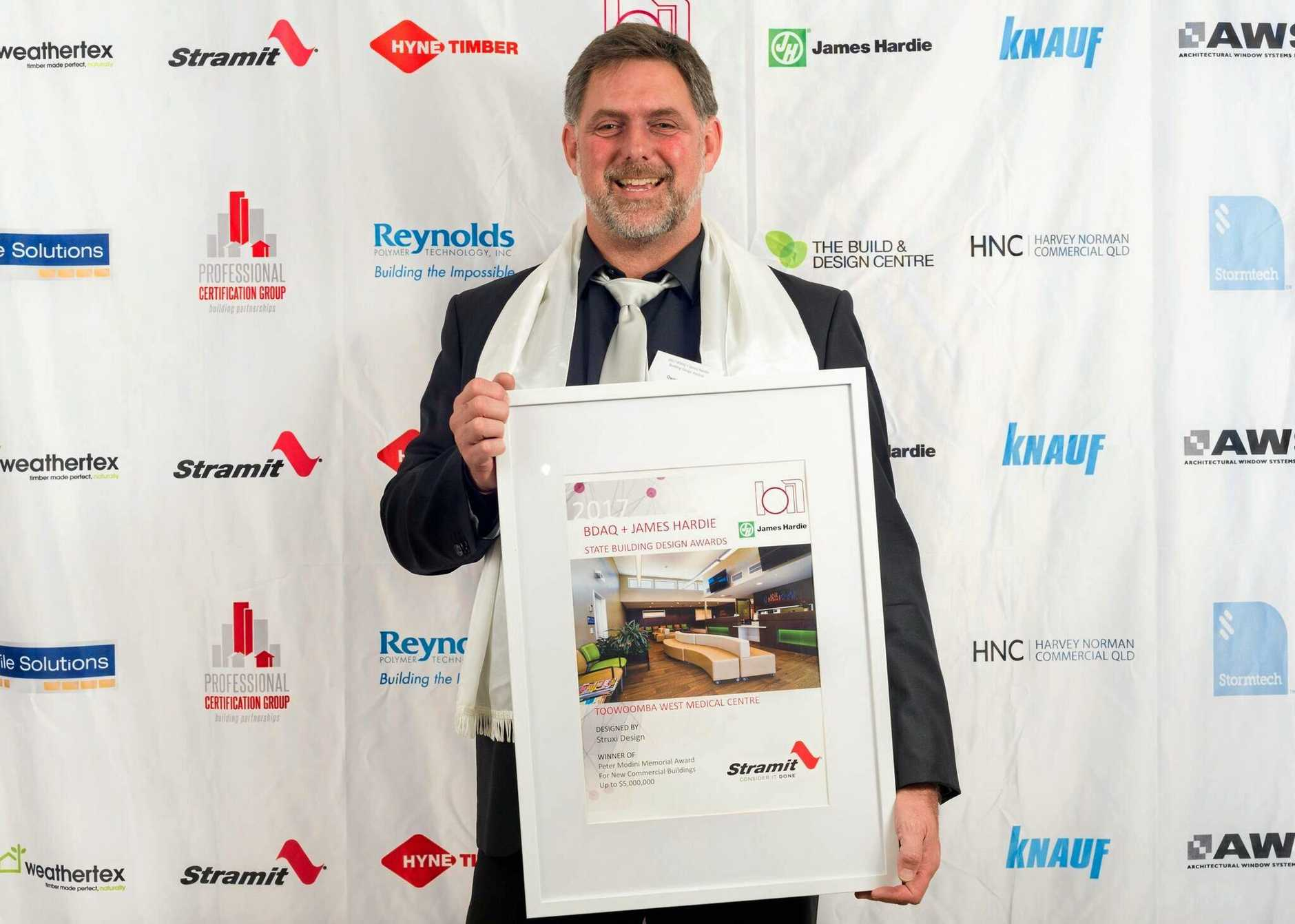 StruXi Design's Owen Kleidon accepted the award for designing Toowoomba West Medical Centre.