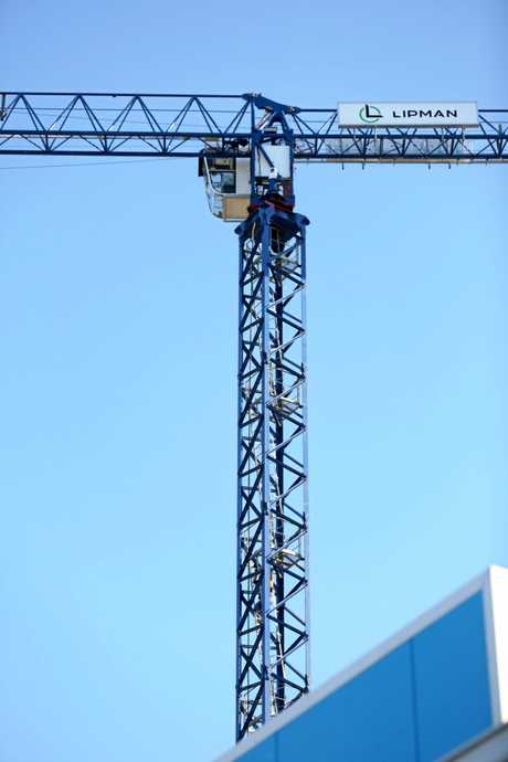 A MAN was been assisted to safety after scaling a crane in the Coffs Harbour CBD.