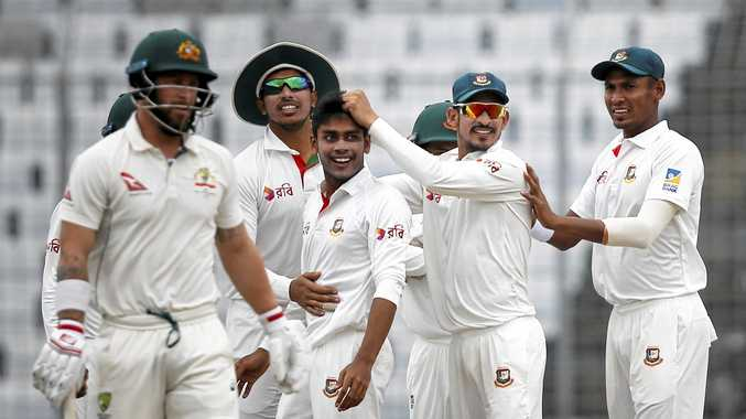 Teammates congratulate Bangladesh's Mehedi Hasan Miraz (centre) after the dismissal of Australia's Matthew Wade (left).