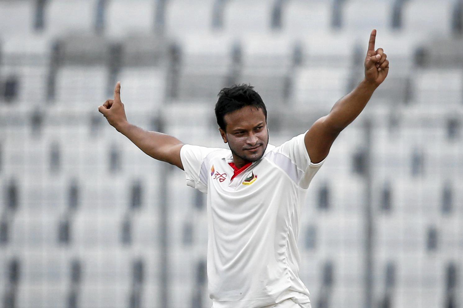 Bangladesh's Sakib Al Hasan celebrates the dismissal of Australia's Matt Renshaw during the second day of their first test cricket in Dhaka, Bangladesh, Monday, Aug. 28, 2017. (AP Photo/A.M. Ahad)