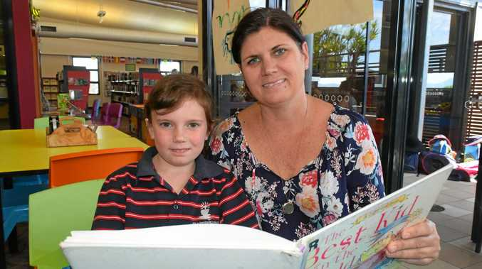 BOOKWORM: Molly Ford, 6, and mum Bobbie Ford enjoy reading time at Gladstone City Library.