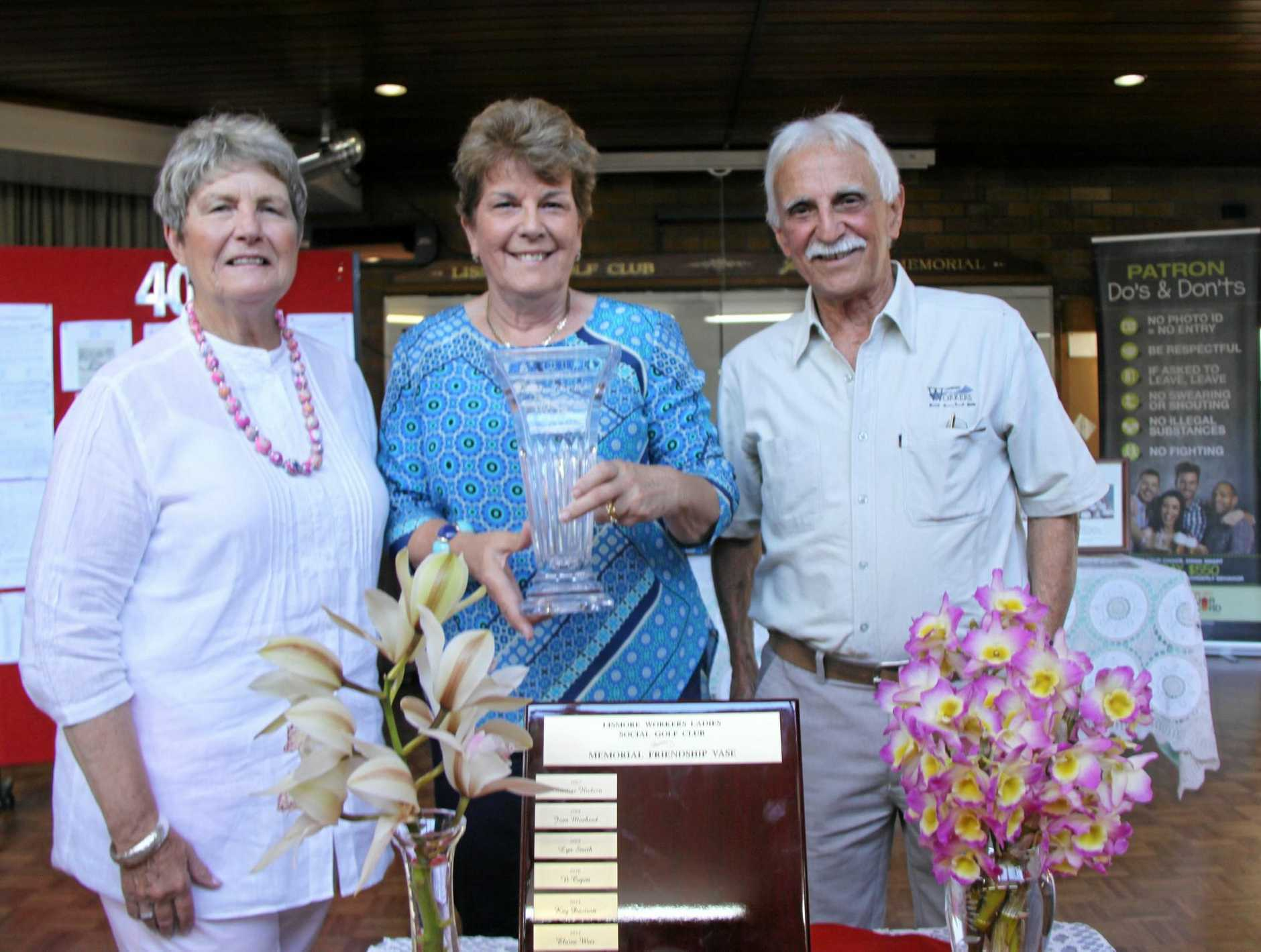TO THE FORE: Alison Shepherd was presented with the Memorial Friendship Vase at the Lismore Worker's Club Ladies Social Golf Club's 40th anniversary luncheon. L-R LSGC president Nancy Silvano, Alison Shepherd and LWC treasurer Barry Lamperd.