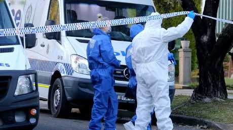 Forensics officers remained at the house throughout yesterday. Picture: John Grainger