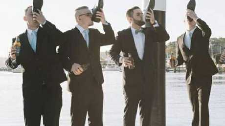 Jordan Wilson, second from right, does a 'shoey' with fellow wedding guests.