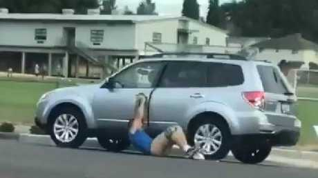 A suspected carjacker in the US was dragged pantless down a road.
