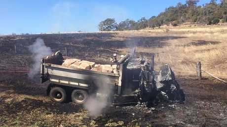 A truck caught  fire after a collision with a car north-west of Toowoomba.