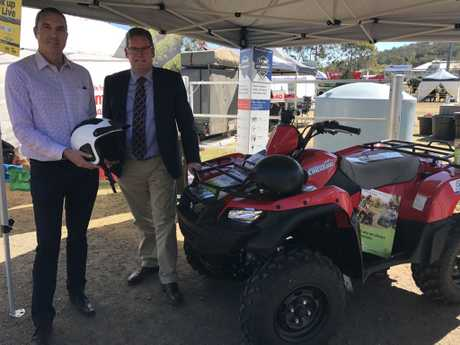 FCAI ATV Manager Mark Collins (left) and Federal Member for Groom, Dr John McVeigh MP (right) publicly launch the Shark ATV helmet giveaway, an industry initiative, at the Queensland Beef Expo in Toowoomba yesterday.