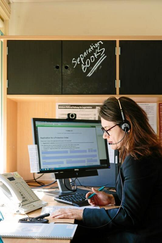 A Women's Legal Service Queensland helpline professional takes a call from a client.