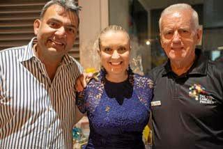 Ravi and Vanessa Ramswarup and Colin Reynolds were thrilled with the auction results at the fundraiser.
