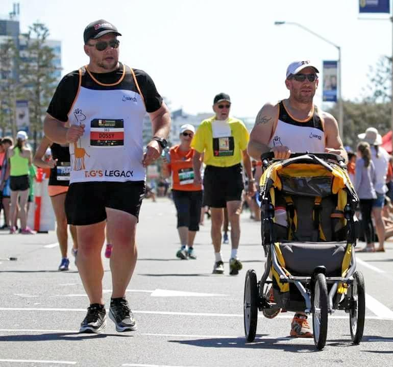 TG LEGACY: Troy Austin ran the Sunshine Coast Marathon to raise awareness for still birth. But onlookers were quick to shout about his empty pram - not knowing the story behind the absent child.