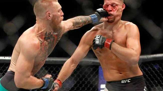 Conor McGregor (L) hits Nate Diaz with a left during their welterweight rematch at UFC 202. Photo:Getty Images