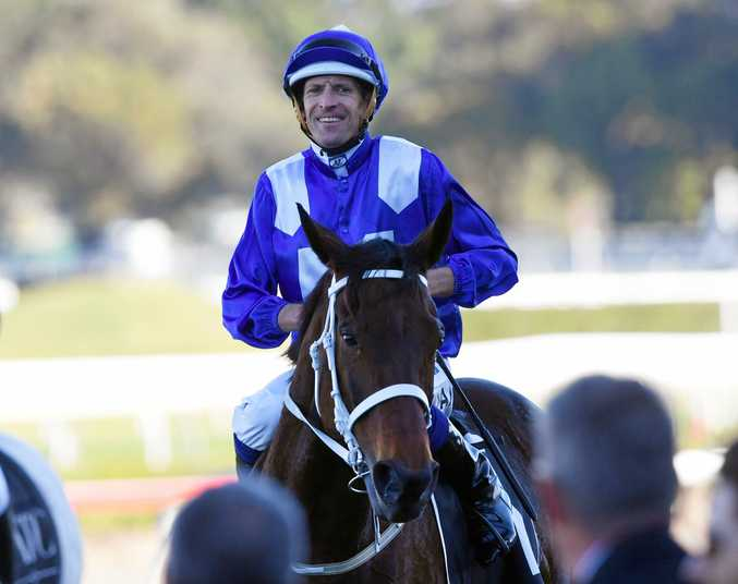 18 down ... Jockey Hugh Bowman, on Winx, is all smiles after winning the Bob Ingham Warwick Stakes in Sydney earlier this month.