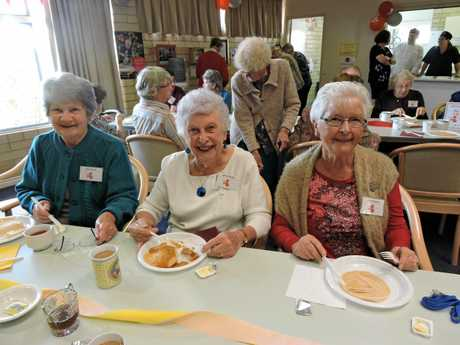 Nothing like a little pancakes and cake to cheer up Glad Walker, Norma Raabe and Marg Simpson at the festive brekkie unveiling of the name change from RSL Care to Bolton Clarke Chelsea.