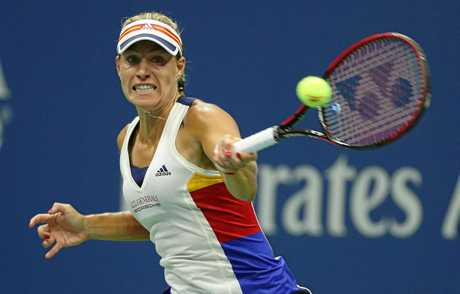 Angelique Kerber hits a return during her first-round loss to Naomi Osaka