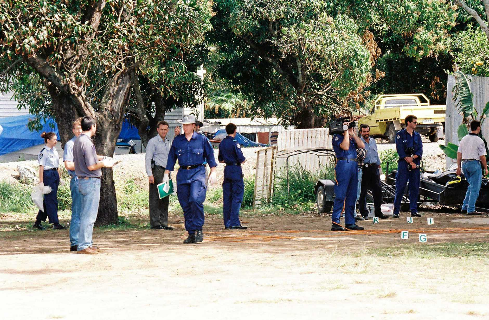 Police officers investigate the scene of a shoot-out between bikies at Cremorne on August 31st, 1997.
