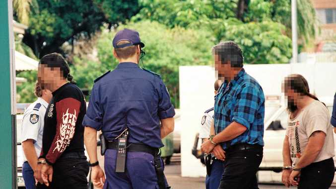Handcuff bikies on their way to the Mackay Courthouse on the 4th September, 1997.