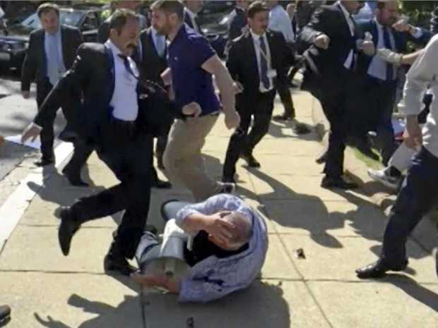 In this file frame grab from video, members of Turkish President Recep Tayyip Erdogan's security detail are shown violently reacting to peaceful protesters during his trip to Washington in May.