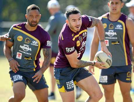 Darius Boyd passes the ball during Broncos training in Red Hill.