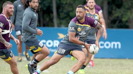 Benji Marshall looks to pass at Broncos training in Red Hill.