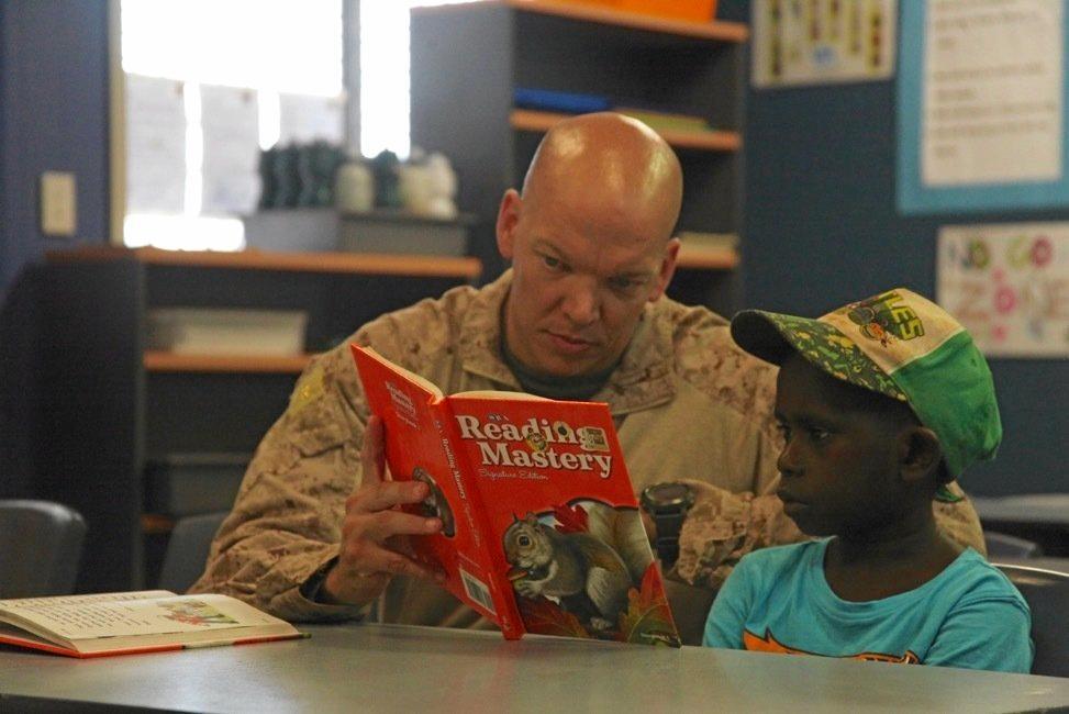 US Marine Major Matt Bartels helps out at Warruwi elementary school on South Goulburn Island during Exercise Crocodile Strike.
