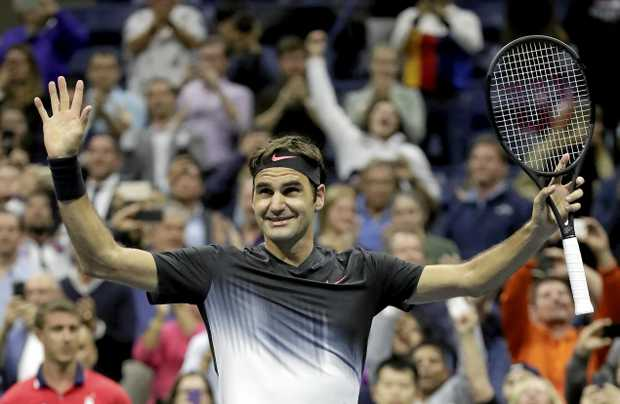 Roger Federer celebrates after defeating Frances Tiafoe