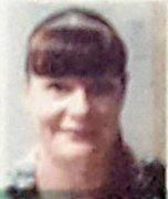 The 40-year-old woman is described as Caucasian in appearance, 175cm tall, black hair with a dyed red fringe.
