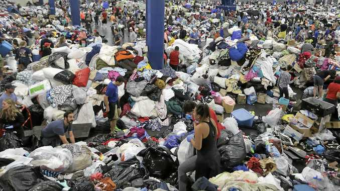 Donated items clothes are sorted and screened at the George R Brown Convention Center in Houston as Tropical Storm Harvey inches its way through the area.