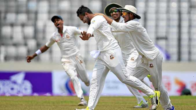 Teammates congratulate Bangladesh's Sakib Al Hasan, second left, after the dismissal of Australia's Glenn Maxwell
