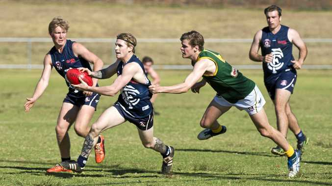 LAST MEETING: Coolaroo's Josh Adams tries to get a kick away while under pressure from Goondiwindi's Jack Martin on August 12.
