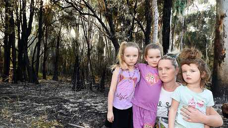 Petersens Rd, Craignish resident Amanda Moore with her children Jazmin, Summer and Willow - deeply concerned about reports the fires have been deliberately lit.